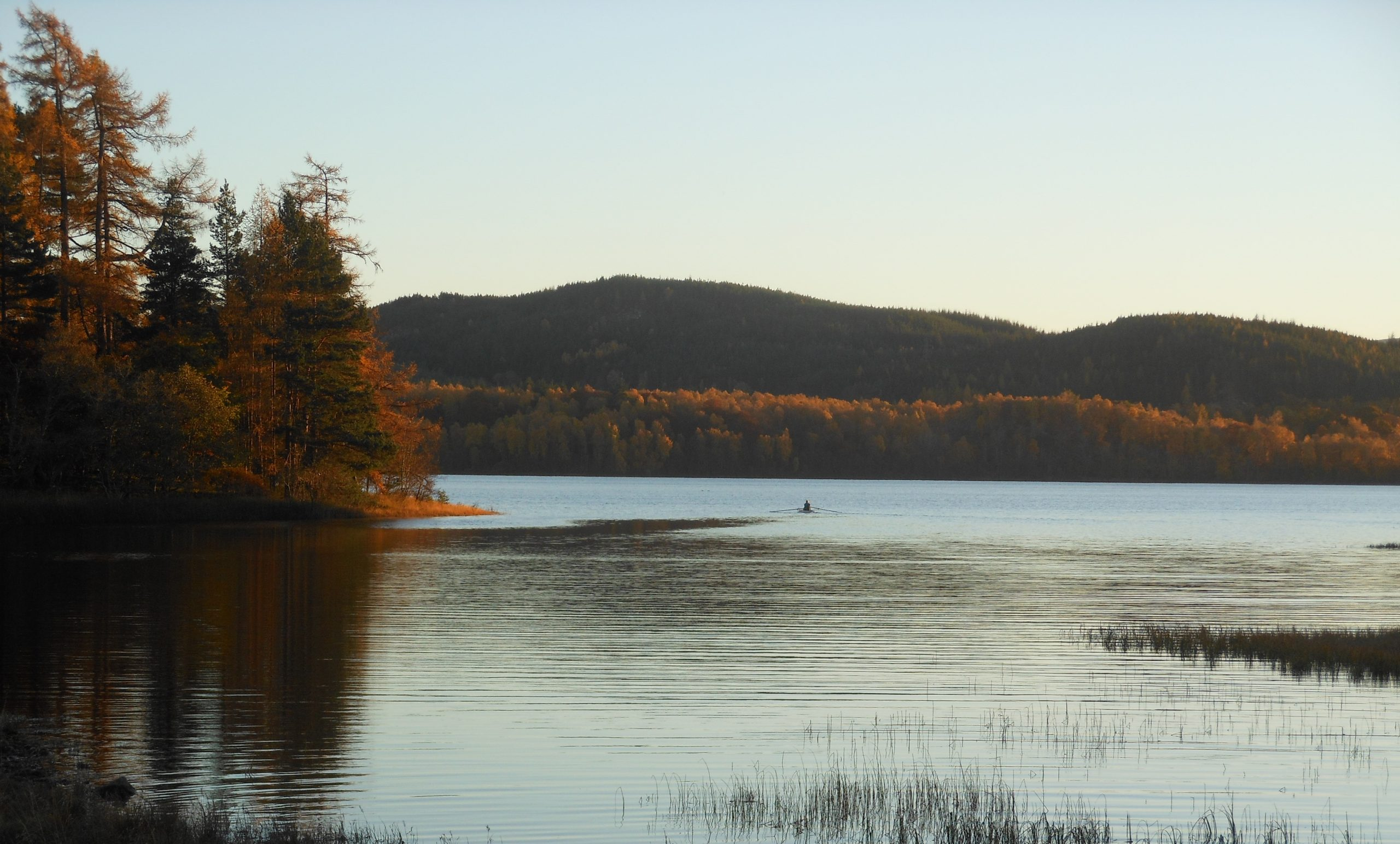 Loch Insh in Autumn with canoe