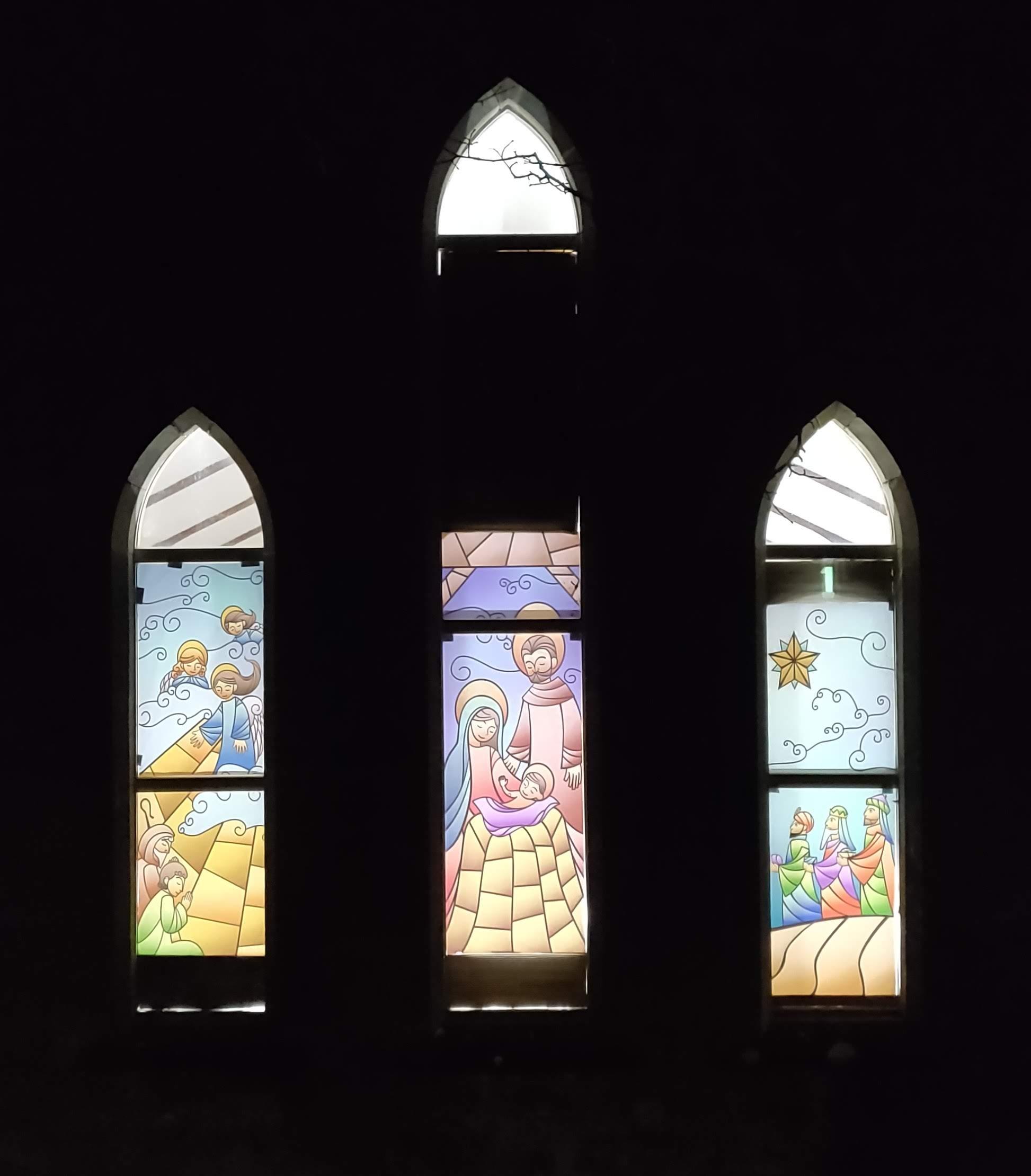 Stained glass nativity scene in church windows